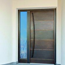 Schönheit trifft Eleganz - Rubner Haustüren mit Aufdoppelung in Bronze oder Schwarzstahl